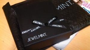 It arrived in a cute black bubble wrap envelope branded JewelMint. Inside was a ribboned black box, about 4x5x1 inch. I appreciate the external presentation.